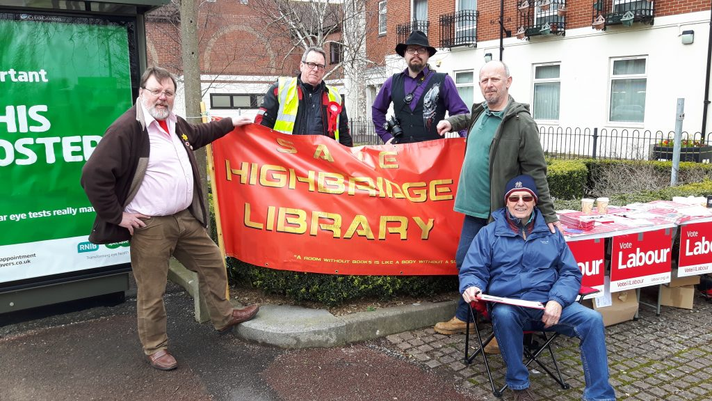"photo - street stall and banner at Highbridge Library - ""Save Highbridge Library"""